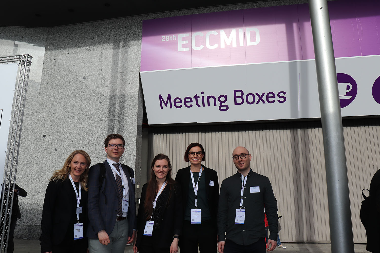 The 1928D team at ECCMID standing in front of entrance