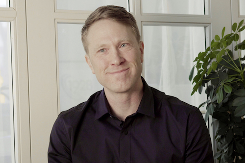 Fredrik Dyrkell, CTO at 1928, sits in front of the camera.